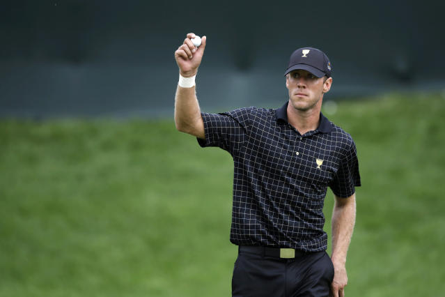 International team player Graham DeLaet, of Canada, reacts after a putt on the 16th hole during the single matches at the Presidents Cup golf tournament at Muirfield Village Golf Club Sunday, Oct. 6, 2013, in Dublin, Ohio. (AP Photo/Darron Cummings)
