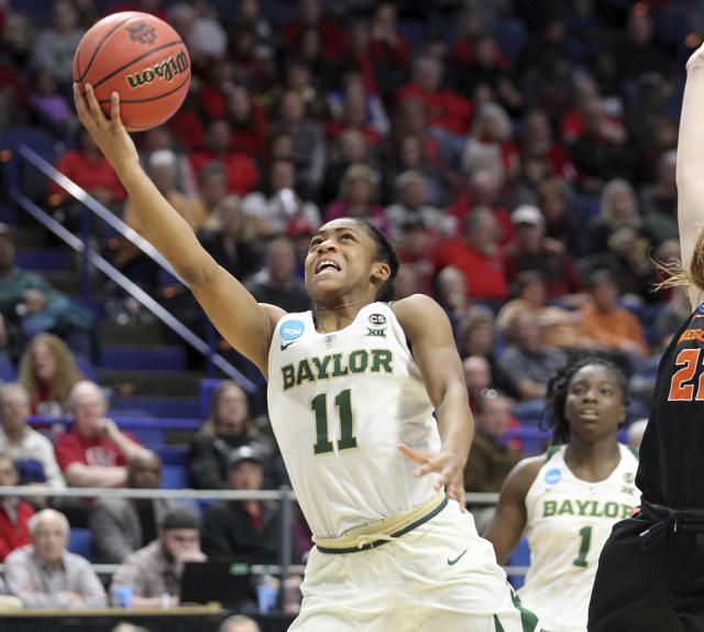 Baylor's Alexis Morris (11) shoots near Oregon State's Kat Tudor during the second half of an NCAA women's college basketball tournament regional semifinal Friday, March 23, 2018, in Lexington, Ky. (AP Photo/James Crisp)