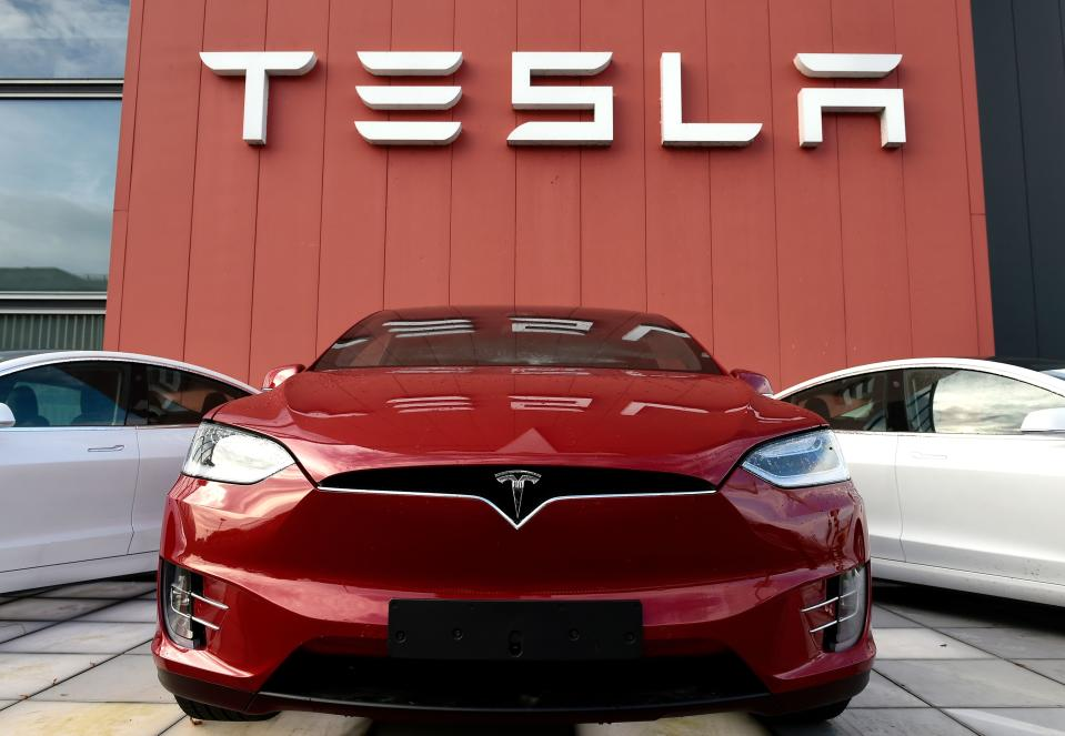 The logo marks the showroom and service center for the US automotive and energy company Tesla in Amsterdam on October 23, 2019. (Photo by JOHN THYS / AFP) (Photo by JOHN THYS/AFP via Getty Images)