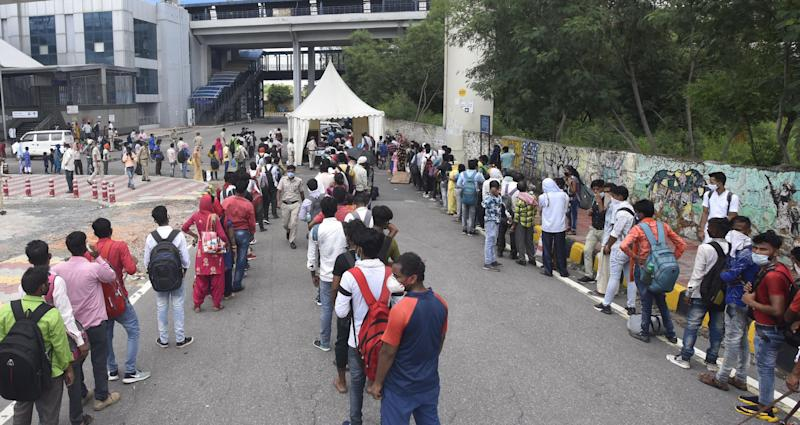 People line up for Covid-19 rapid antigen tests, at a testing facility for travellers at Anand Vihar Bus Terminal, on August 16, 2020 in New Delhi, India. (Photo by Sonu Mehta/Hindustan Times via Getty Images)