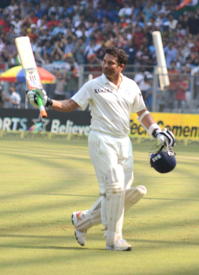 Indian cricketer Sachin Tendulkar walks back to pavilion during the 2nd day of the 2nd Test Match between India and West Indies at Wankhede Stadium in Mumbai on Nov.15, 2013. (Photo: Sandeep Mahankal/IANS)