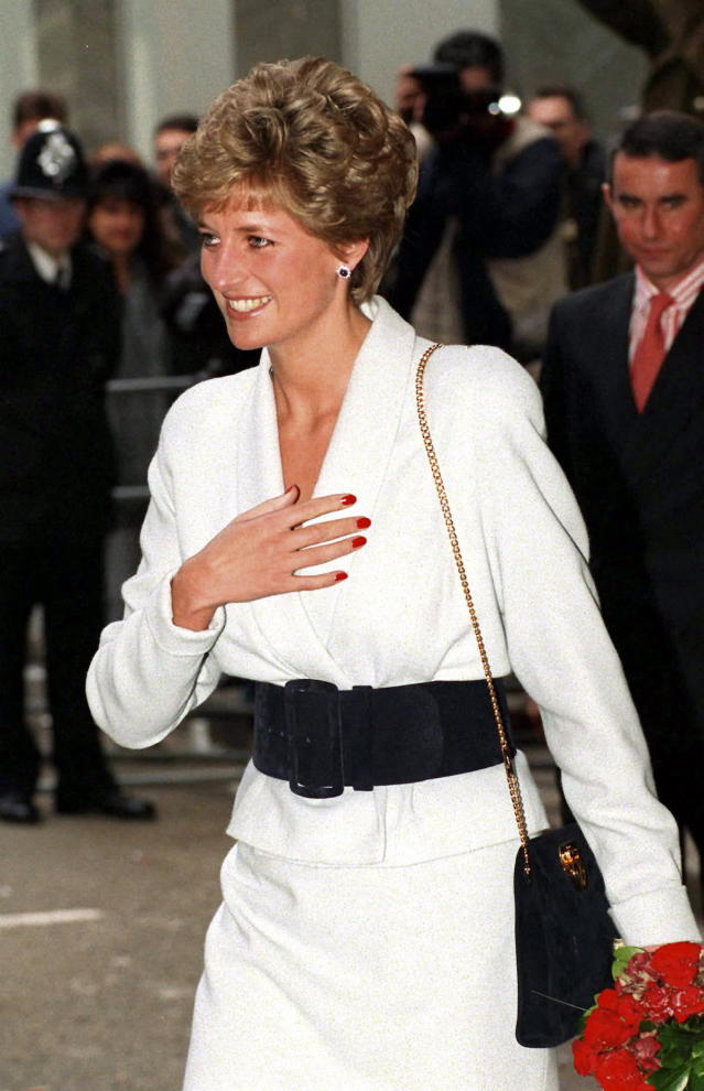 <p>Here, the princess boldly takes her red nails to daytime, effectively making brights during the day an acceptable sartorial choice for women. (Photo: Tim Graham/Getty Images) </p>