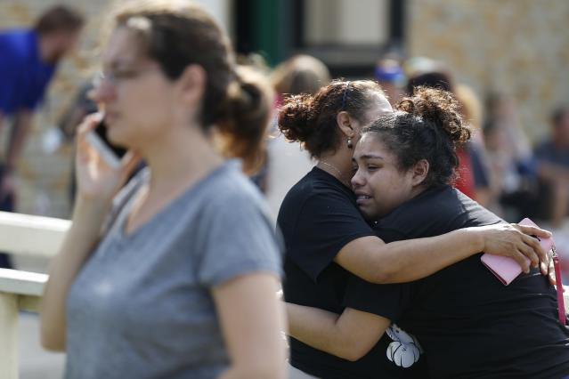 <p>Santa Fe High School junior Guadalupe Sanchez, 16, cries in the arms of her mother, Elida Sanchez, after reuniting with her at a meeting point at a nearby Alamo Gym fitness center following a shooting at Santa Fe High School in Santa Fe, Texas, on Friday, May 18, 2018. (Photo: Michael Ciaglo/Houston Chronicle via AP) </p>