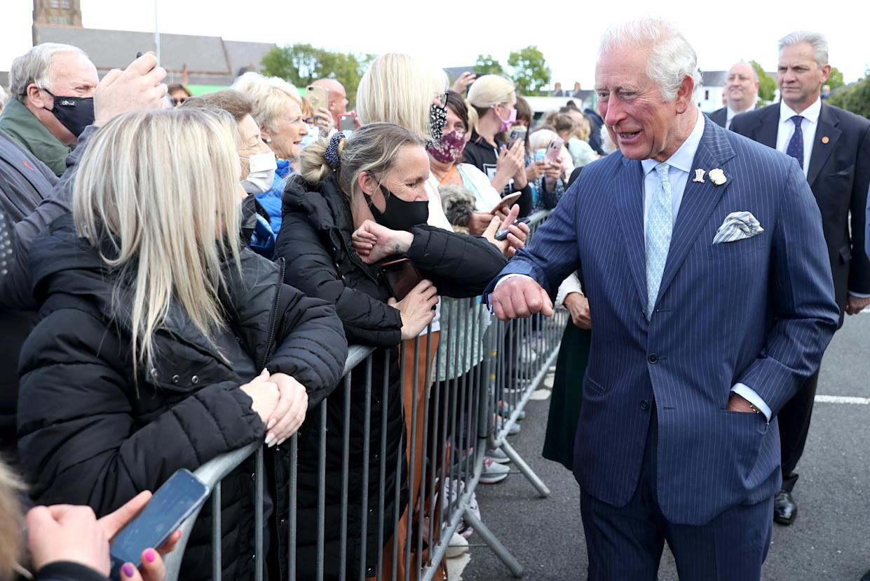 BANGOR, NORTHERN IRELAND - MAY 19: Prince Charles, Prince of Wales meets wellwishers as he visits Bangor open air market with Camilla, Duchess of Cornwall on May 19, 2021 in Bangor, Northern Ireland. (Photo by Chris Jackson - Pool/Getty Images)