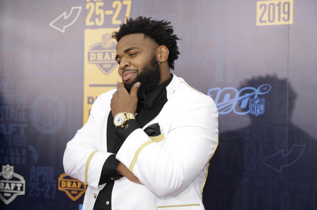 Clemson defensive tackle Christian Wilkins walks the red carpet ahead of the first round at the NFL football draft, Thursday, April 25, 2019, in Nashville, Tenn. (AP Photo/Mark Humphrey)