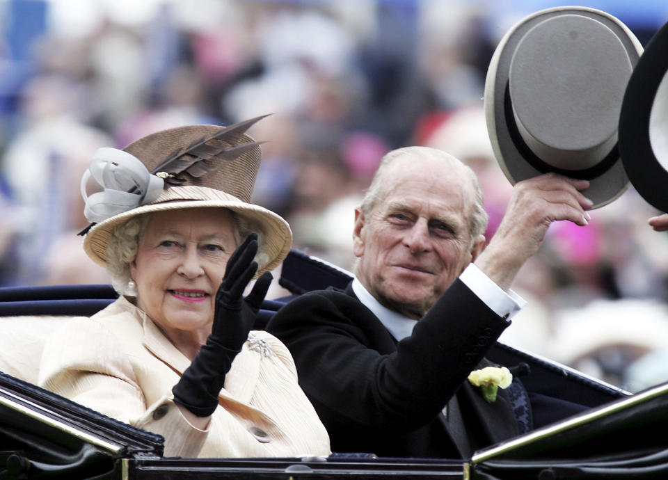 YORK, ENGLAND - JUNE 16: The Queen and Prince Phillip are seen arriving in the Royal Carriage on the third day of Royal Ascot 2005, Ladie's Day, at York Racecourse on June 16, 2005 in York, England. One of the highlights of the racing and social calendars, Royal Ascot was founded in 1711 by Queen Anne and royal patronage continues to the present day with a Royal Procession taking place in front of the grandstands each day. This year's Royal Meeting is relocated to York Racecourse due to a major redevelopment programme at Ascot, due to re-open in 2006. (Photo by Chris Jackson/Getty Images)  *** Local Caption *** Queen Elizabeth II; Prince Phillip