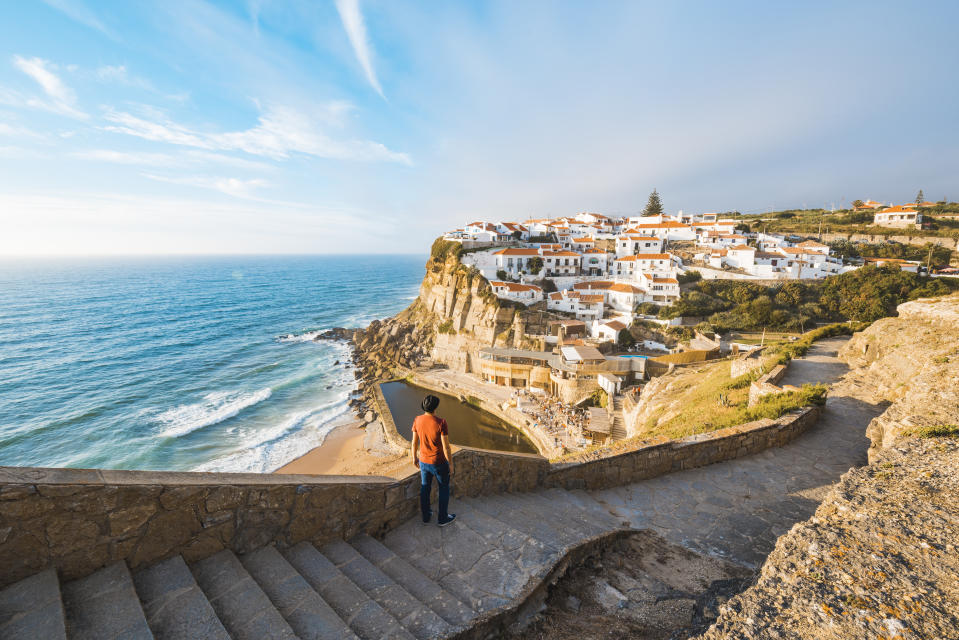 Tourist admiring the view in Azenhas do Mar, Lisbon. (PHOTO: Getty Images)