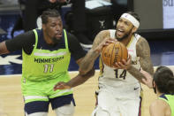 Minnesota Timberwolves center Naz Reid (11) defends against New Orleans Pelicans forward Brandon Ingram (14) in the second quarter during an NBA basketball game, Saturday, Jan. 23, 2021, in Minneapolis. (AP Photo/Andy Clayton-King)