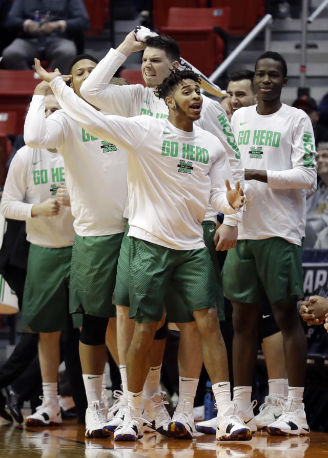 Players on the Marshall bench react during the first half of a second-round NCAA men's college basketball tournament game against West Virginia on Sunday, March 18, 2018, in San Diego. (AP Photo/Gregory Bull)