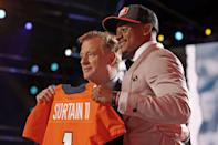 <p>Picked ninth, Alabama cornerback Patrick Surtain II — posing here with NFL Commissioner Roger Goodell — will now play for the Denver Broncos.</p>