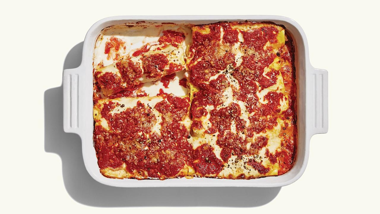 """We're all for a good store-bought marinara (Rao's is our go-to), especially in a recipe with multiple parts. But there is no substitute for homemade béchamel—of this we can be sure. <a href=""""https://www.epicurious.com/recipes/food/views/sausage-and-ricotta-baked-cannelloni?mbid=synd_yahoo_rss"""">See recipe.</a>"""