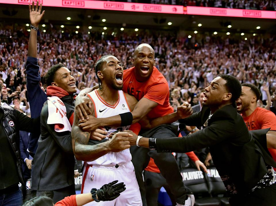 Toronto Raptors forward Kawhi Leonard, second from left, celebrates his game-winning basket as time expired at the end of an NBA Eastern Conference semifinal basketball game against the Philadelphia 76ers, in Toronto on Sunday, May 12, 2019. Toronto won 92-90. (Frank Gunn/The Canadian Press via AP)