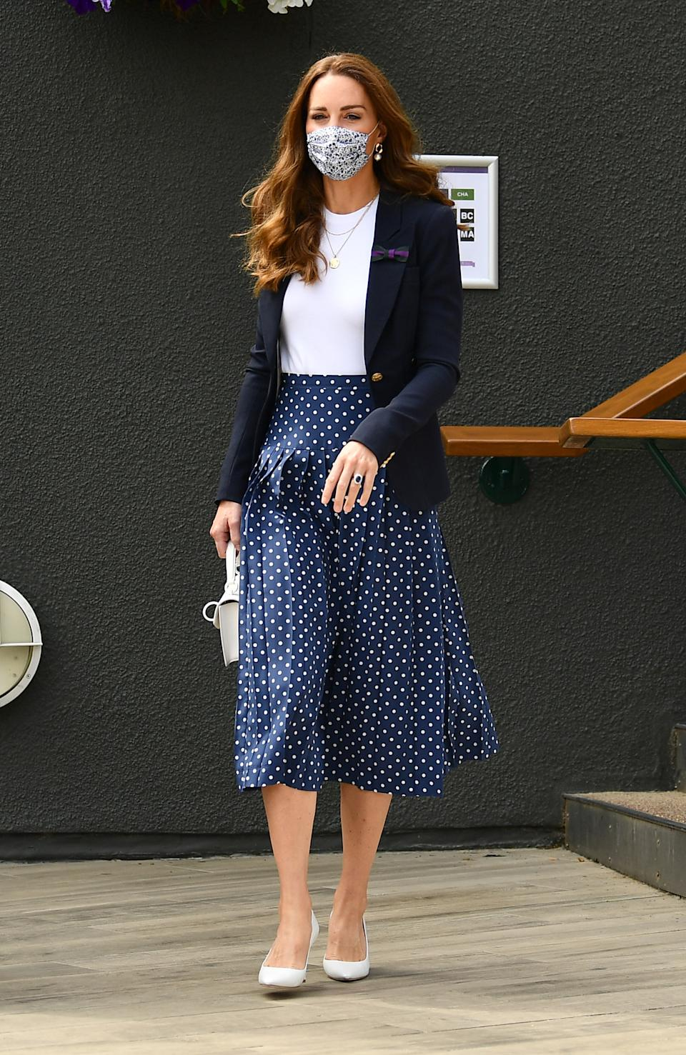 The Duchess of Cambridge arrives for day five of Wimbledon at The All England Lawn Tennis and Croquet Club, Wimbledon.