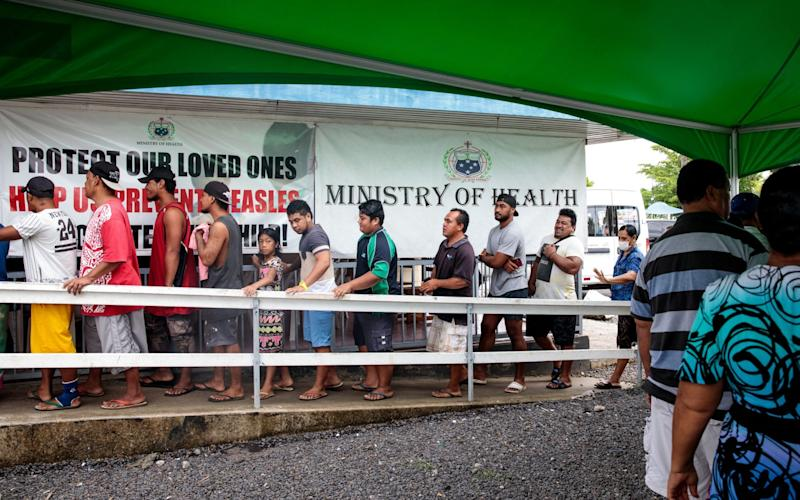People line up to be vaccinated as part of an emergency campaign in Samoa - Jack Taylor