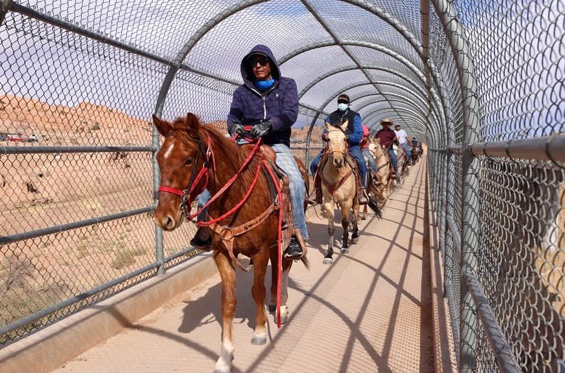A group of Native Americans ride on horseback to the polls on Election Day in Kayenta, Ariz., Tuesday, Nov. 3, 2020. (Larry Price via AP)