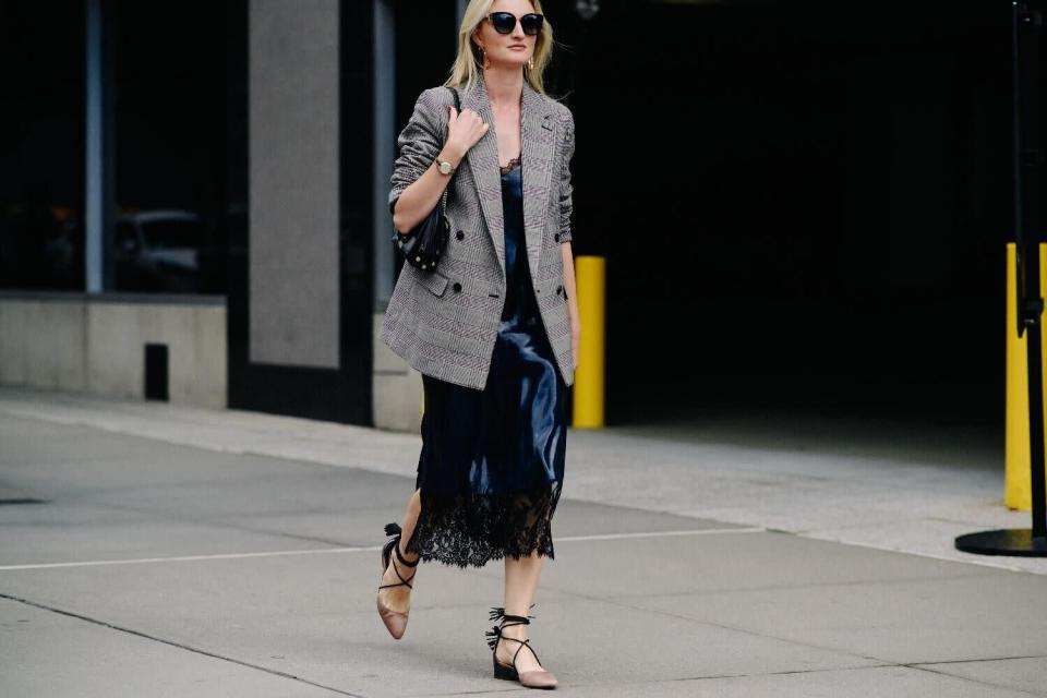 <p>Possibly the biggest street style trend to come out of SS18 was the oversized blazer. Everyone looked like they had raided their grandad's wardrobe in enormous 80s style jackets in a variety of prints. However, the Prince of Wales check was the most popular preference. [Photo: Katz Sinding] </p>