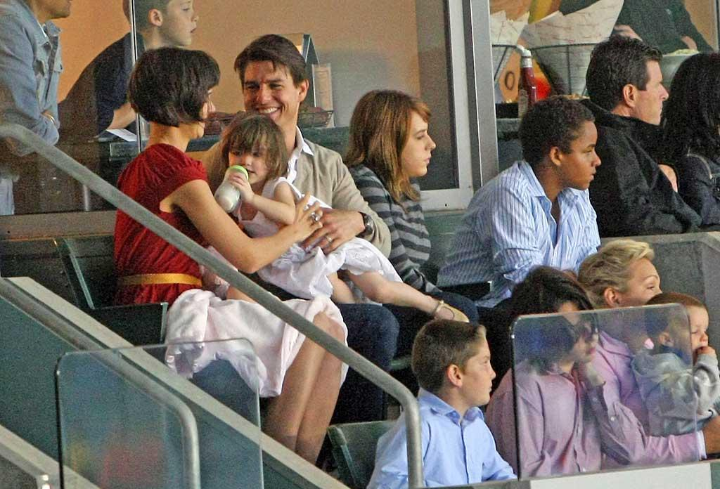 "Katie Holmes, Tom Cruise, and his three children made a rare appearance together at the L.A. Galaxy match Saturday. While Isabella and Connor got caught up in the action, Tom and Katie were distracted by 2-year-old Suri. Jason Winslow/<a href=""http://www.splashnewsonline.com"" target=""new"">Splash News</a> - May 10, 2008"
