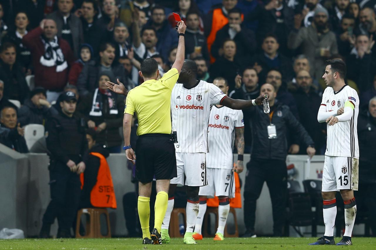 Football Soccer- Besiktas v Olympiacos - UEFA Europa League Round of 16 Second Leg - Vodafone Arena, Istanbul, Turkey - 16/3/17 Besiktas' Vincent Aboubakar receives a red card during their match against Olympiacos. REUTERS/Murad Sezer