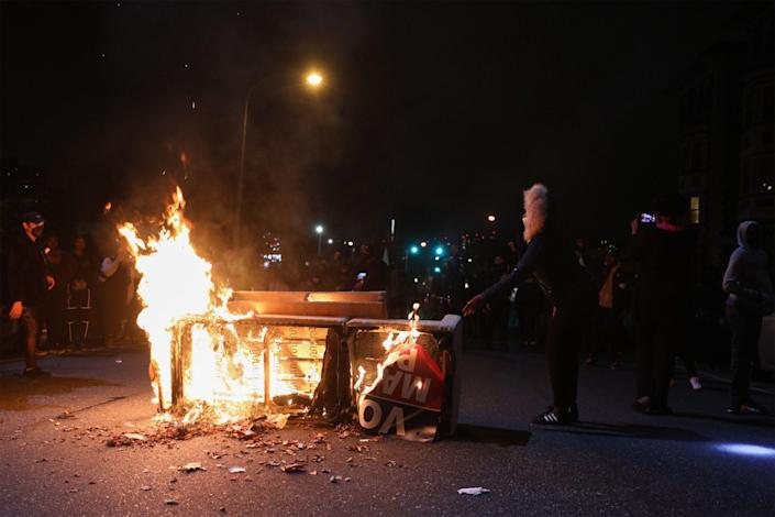 Protesters in Philadelphia burn a barricade on Tuesday night after the killing of Walter Wallace (AFP via Getty Images)