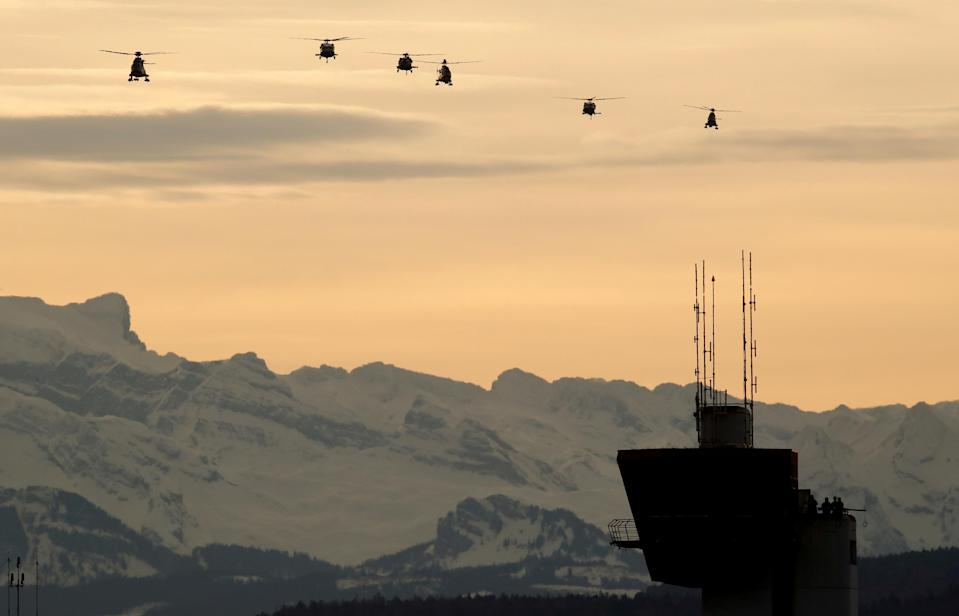 Helicopters approach to land before the arrival of U.S. President Donald Trump at Zurich airport, Switzerland January 25, 2018. REUTERS/Arnd Wiegmann