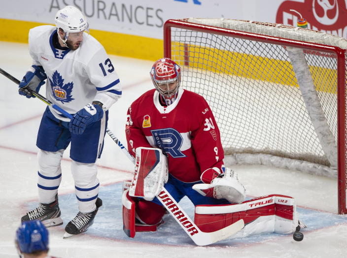 Laval Rocket goaltender Carey Price, right, makes a save as Toronto Marlies' Stefan Noesen looks for the rebound during first-period American Hockey League action in Montreal, Monday, May 17, 2021. Price and Brendan Gallagher are on a one-game conditioning loan to the Rocket before their playoff series against the Toronto Maple Leafs. (Ryan Remiorz/The Canadian Press via AP)
