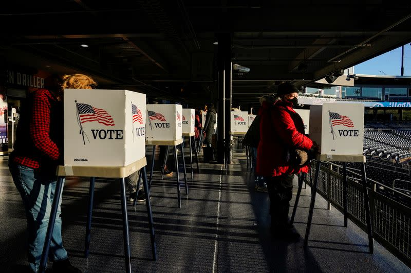 Voters fill out their ballots during early voting at ONEOK Field in Tulsa
