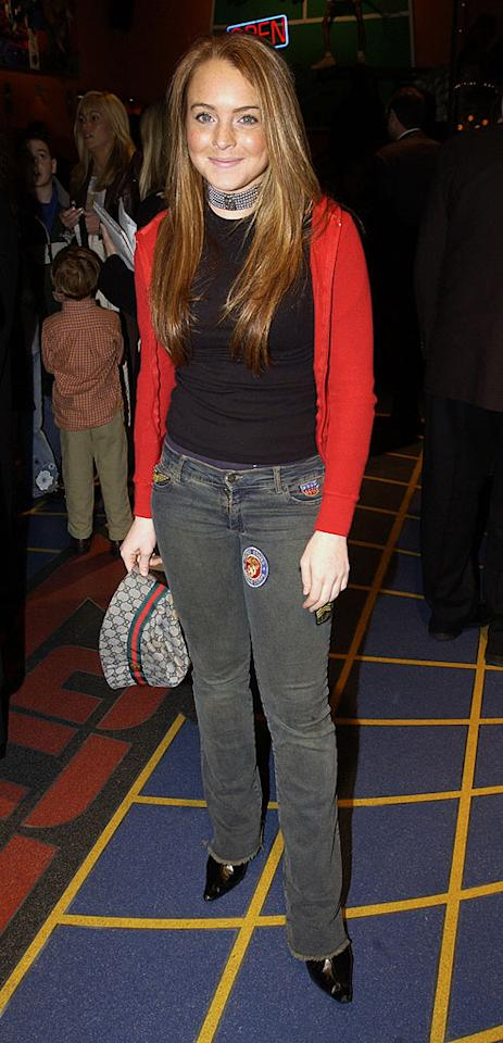 "In 2002, a grown-up 15-year-old Lohan was out to support her ""Parent Trap"" co-star Dennis Quaid at the New York premiere of his baseball film, ""The Rookie."" KevinMazur/<a href=""http://www.wireimage.com"" target=""new"">WireImage.com</a> - March 26, 2002"