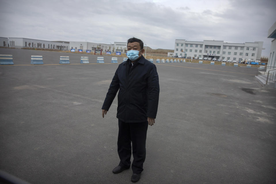 Urumqi Public Security Bureau director Zhao Zhongwei stands in a parking lot outside the inmate detention area at the Urumqi No. 3 Detention Center in Dabancheng in western China's Xinjiang Uyghur Autonomous Region on April 23, 2021. (AP Photo/Mark Schiefelbein)