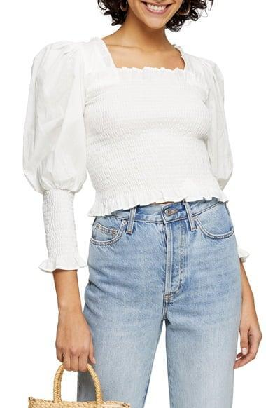 <p>I can't get over this <span>Topshop Smocked Puff Sleeve Crop Top</span> ($58).</p>