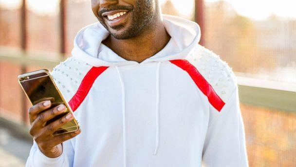 PHOTO: A man smiles as he uses his cell phone in this undated stock photo. (STOCK PHOTO/Getty Images)
