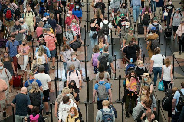 PHOTO: Travelers queue up in long lines to pass through the south security checkpoint in Denver International Airport, on June 16, 2021, in Denver. (David Zalubowski/AP)