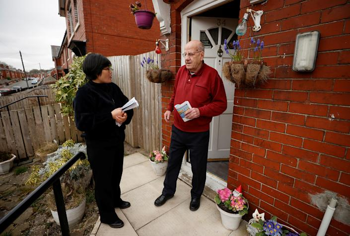 Jihyun Park, who fled North Korea before settling in Britain, talks with a local resident while out delivering leaflets after deciding to stand for election as a Conservative party candidate in the upcoming local elections in the Moorside Ward in Bury, Britain, March 22, 2021. Picture taken March 22, 2021. REUTERS/Phil Noble