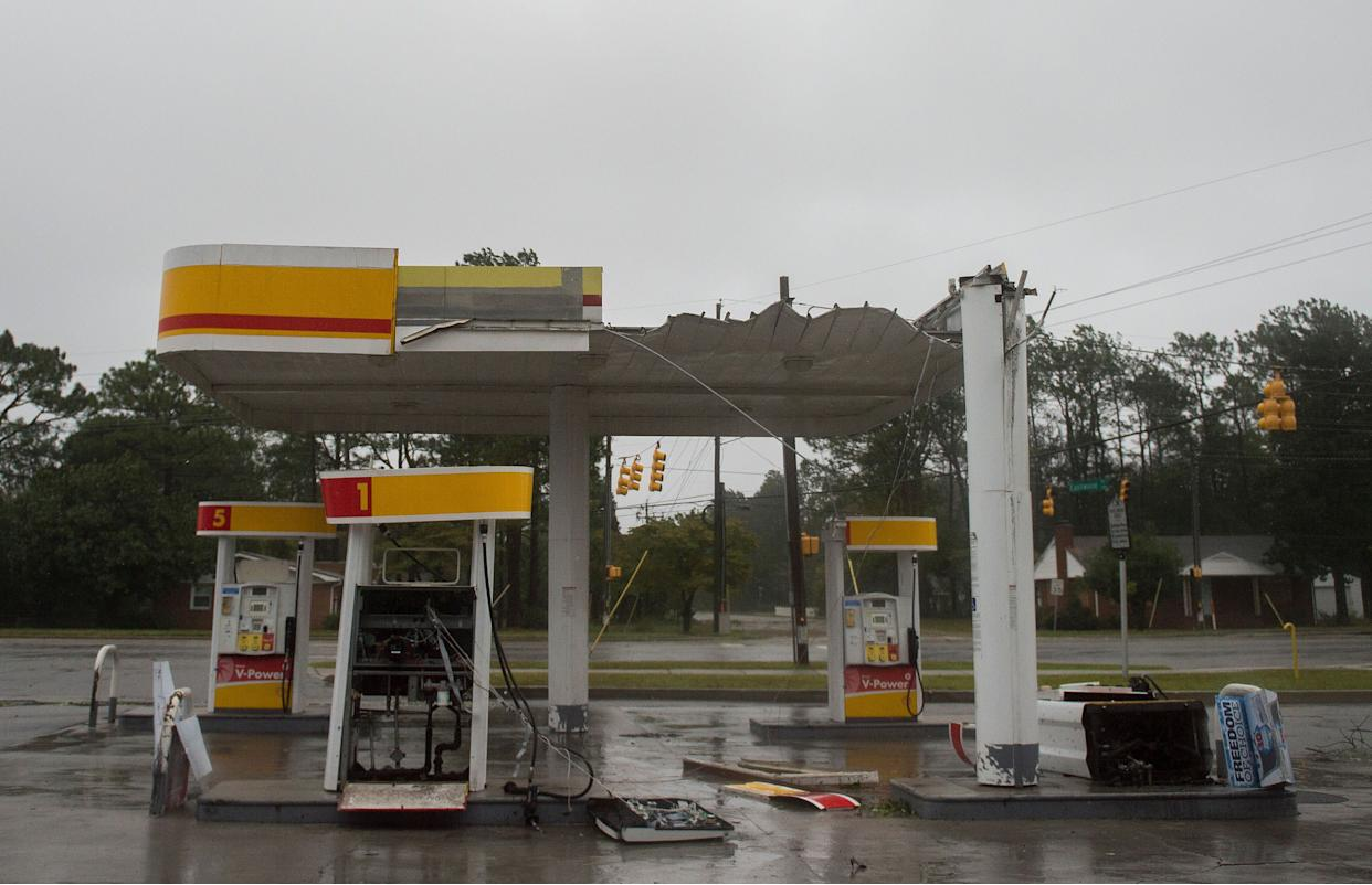 The roof of a gas station is destroyed from strong winds as Hurricane Florence passes over in Wilmington, North Carolina on Friday.