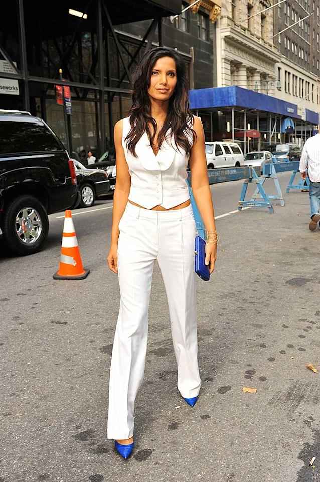 """Top Chef"" hostess with the mostest Padma Lakshmi perfectly paired her sleek white outfit with beautiful blue heels and a matching clutch while out and about in NYC. Edward Opinaldo/<a href=""http://www.splashnewsonline.com"" target=""new"">Splash News</a> - September 12, 2008"