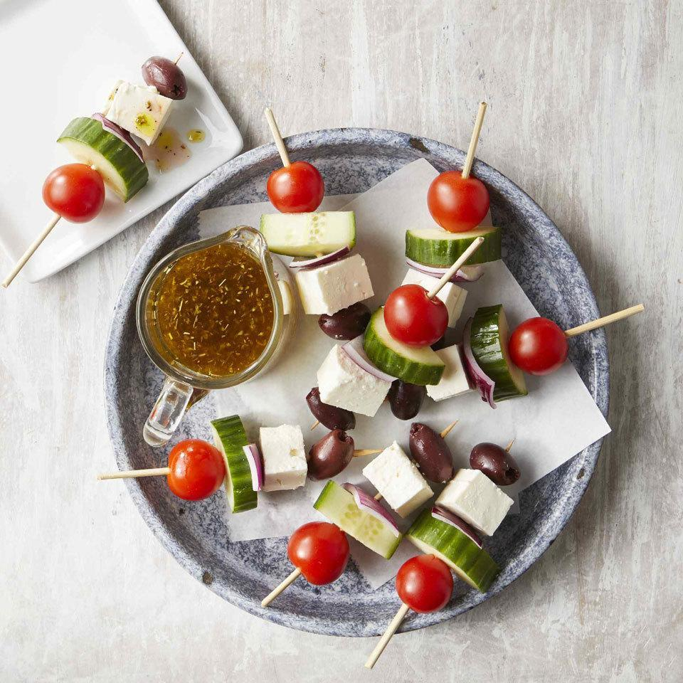 <p>Turn classic Greek salad into finger food appetizers on a stick. The cute presentation is also super easy to prepare and makes for easy eating at a cocktail party or on game day. Just skewer tomatoes, cucumber, onion, feta and olives and serve with a side of Greek salad dressing for dipping!</p>