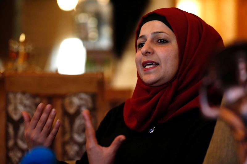 Khalida Muslih, the wife of Palestinian prisoner Mohammed Muslih, talks to journalists at her home in the West Bank city of Ramallah (AFP Photo/Abbas Momani)
