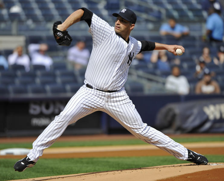 New York Yankees starter Andy Pettitte delivers a pitch to the Toronto Blue Jays during the first inning of the first baseball game of a doubleheader, Wednesday, Sept. 19, 2012, at Yankee Stadium in New York. (AP Photo/Bill Kostroun)