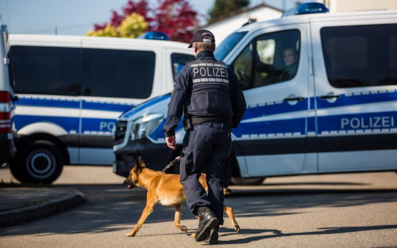 Police at the scene following the arrest of A Russian-German man in connection with the Dortmund team bus attack - Credit: CHRISTOPH SCHMIDT/AFP/Getty Images