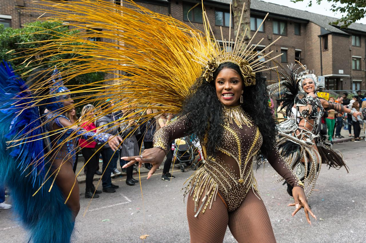 <p>The grand finale of the Notting Hill Carnival, during which performers present their costumes and dance to the rhythms of the mobile sound systems or steel bands along the streets of West London. Hundreds of thousands revellers are expected to take part in Notting Hill Carnival. (Photo: Wiktor Szymanowicz / Barcroft Media via Getty Images) </p>