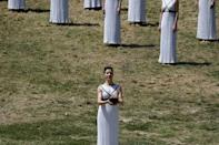Greek actress Katerina Lehou, playing the role of High Priestess, carries the Olympic flame during the dress rehearsal for the Olympic flame lighting ceremony for the Rio 2016 Olympic Games at the site of ancient Olympia in Greece. REUTERS/Alkis Konstantinidis