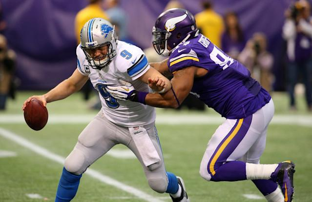 MINNEAPOLIS, MN - DECEMBER 29: Matthew Stafford #9 of the Detroit Lions gets sacked by Everson Griffen #97 of the Minnesota Vikings on December 29, 2013 at Mall of America Field at the Hubert H. Humphrey Metrodome in Minneapolis, Minnesota. (Photo by Adam Bettcher/Getty Images)