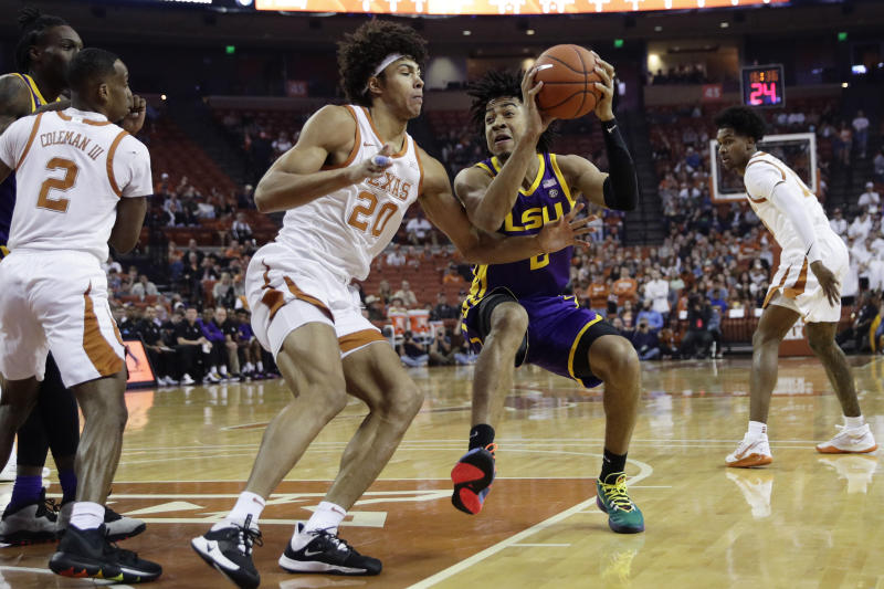 LSU forward Trendon Watford (2) looks to shoot past Texas forward Jericho Sims (20) during the first half of an NCAA college basketball game, Saturday, Jan. 25, 2020, in Austin, Texas. (AP Photo/Eric Gay)