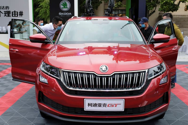 Visitors check a Skoda vehicle at a sales event in Shanghai
