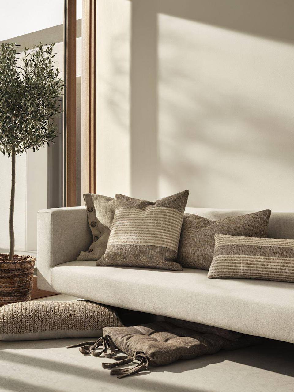 """<p>Create a cosy and personal expression at home with the new range of scatter <a href=""""https://www.housebeautiful.com/uk/lifestyle/shopping/g36003442/floor-cushions/"""" rel=""""nofollow noopener"""" target=""""_blank"""" data-ylk=""""slk:cushions"""" class=""""link rapid-noclick-resp"""">cushions</a> and luxurious blankets. Handwoven by skilled weavers, the plant-dyed cushions will change colour as you wash them, making them even more inimitable. </p><p><a class=""""link rapid-noclick-resp"""" href=""""https://go.redirectingat.com?id=127X1599956&url=https%3A%2F%2Fwww2.hm.com%2Fen_gb%2Fhome.html&sref=https%3A%2F%2Fwww.housebeautiful.com%2Fuk%2Flifestyle%2Fshopping%2Fg36671419%2Fhandm-home-love-of-craft-collection-artisans%2F"""" rel=""""nofollow noopener"""" target=""""_blank"""" data-ylk=""""slk:COMING SOON"""">COMING SOON</a></p>"""