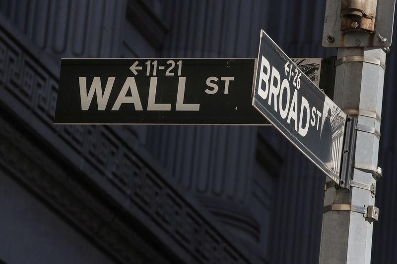Street signs for Broad St. and Wall St. are seen outside of the NYSE in New York