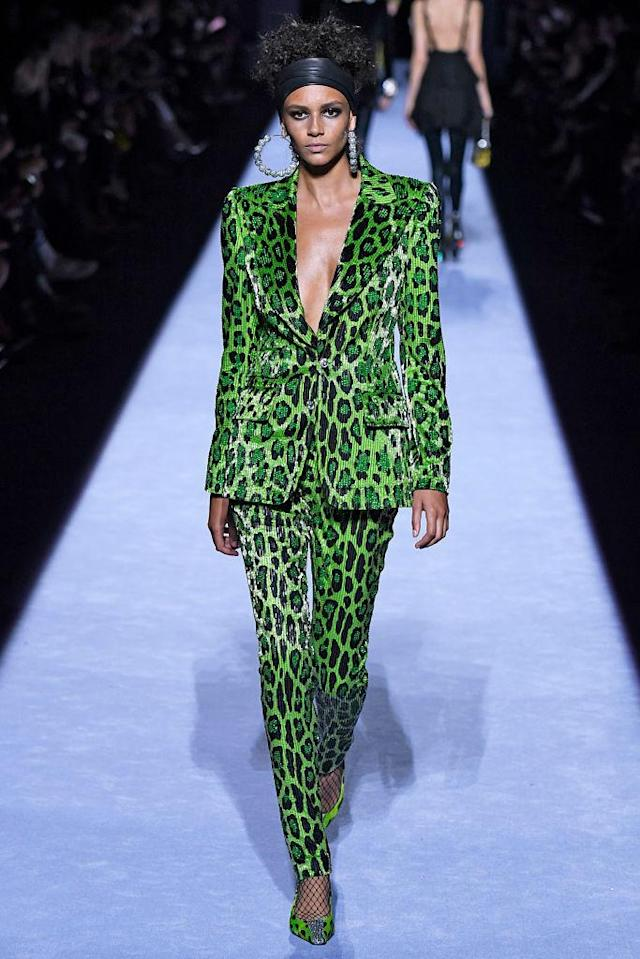 <p>Model wears a green leopard pantsuit at the fall 2018 Tom Ford show. (Photo: Getty Images) </p>