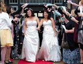<p>Blushing brides walk down the aisle celebrating their wedding and the Marriage Equality Act passing in New Zealand in 2013.<br></p>