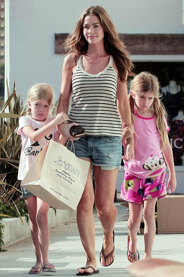 """Denise Richards, who recently adopted a third daughter, took her older two girls -- Sam and Lola, who she had with ex Charlie Sheen -- on a toy shopping spree at celeb hangout Malibu Country Mart on Friday. We bet they picked up a few things for their new little sis, too ... Miguel Aguilar/Gaz Shirley/<a href=""""http://www.pacificcoastnews.com/"""" target=""""new"""">PacificCoastNews.com</a> - July 8, 2011"""