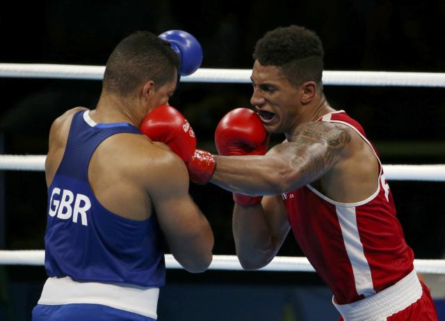 2016 Rio Olympics - Boxing - Final - Men's Super Heavy (+91kg) Final Bout 273 - Riocentro - Pavilion 6 - Rio de Janeiro, Brazil - 21/08/2016. Tony Yoka (FRA) of France and Joseph Joyce (GBR) of Britain compete. REUTERS/Matthew Childs FOR EDITORIAL USE ONLY. NOT FOR SALE FOR MARKETING OR ADVERTISING CAMPAIGNS.
