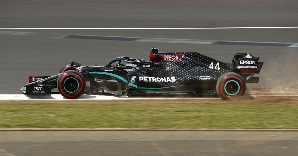 <p>Lewis Hamilton of Great Britain driving the (44) Mercedes AMG Petronas F1 Team Mercedes W11 runs wide during qualifying for the F1 Grand Prix of Great Britain at Silverstone on August 01, 2020 in Northampton, England</p>